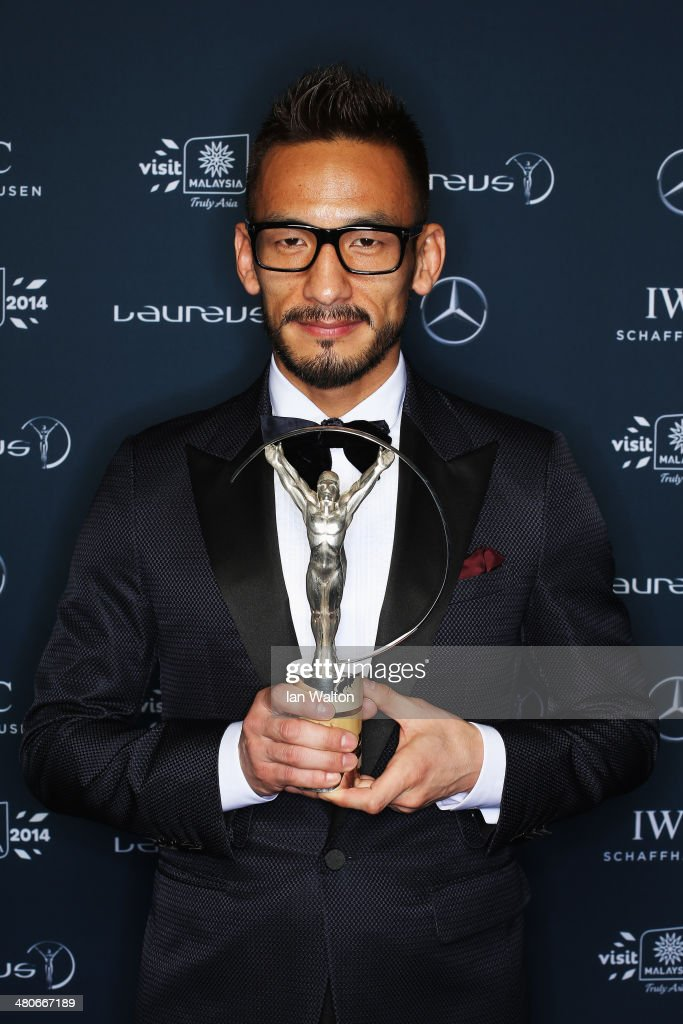 <a gi-track='captionPersonalityLinkClicked' href=/galleries/search?phrase=Hidetoshi+Nakata&family=editorial&specificpeople=211372 ng-click='$event.stopPropagation()'>Hidetoshi Nakata</a> poses with the trophy during the 2014 Laureus World Sports Awards at the Istana Budaya Theatre on March 26, 2014 in Kuala Lumpur, Malaysia.