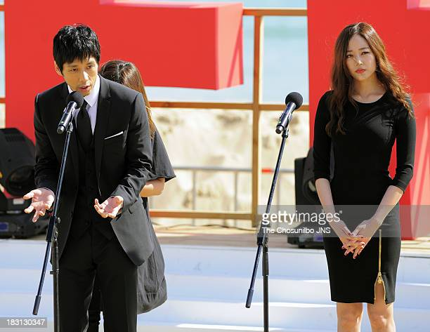 Hidetoshi Nishijima and Kim HyoJin attend a outdoor greeting of 'Genome Hazard' during the 18th Busan International Film Festival at the Haeundae...