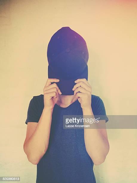 Hiding behind cap