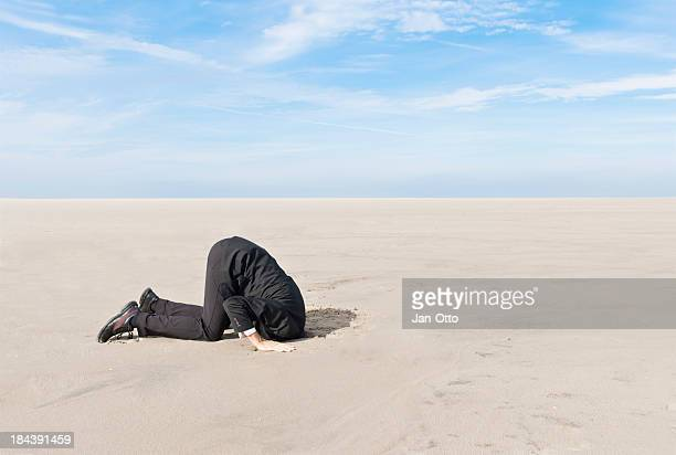 Hiding head in sand