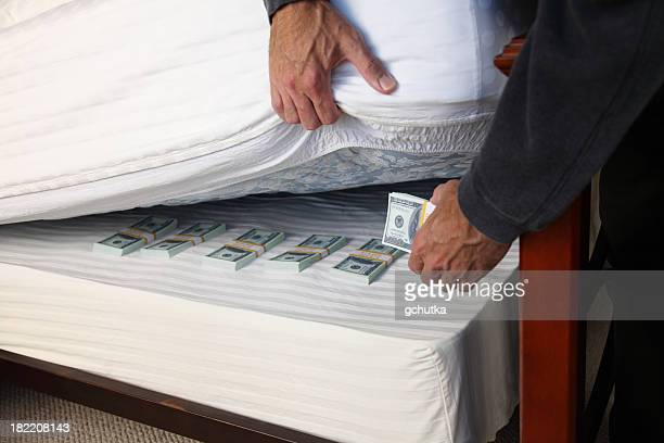 Hiding Money Under The Mattress