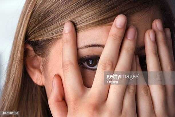 Hiding Teenage Woman, Hands Covering Peeking Eyes and Face