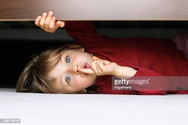 Esconder bajo una cama