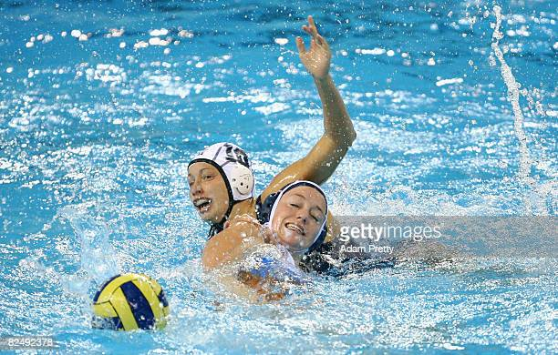 Hiefke Van Belkum of Netherlands and Alison Gregorka of the United States battle for the ball during the gold medal water polo match held at the...