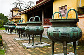 Hien Lam Pavilion and seven of Nine Dynastic Urns in To Mieu Temple Complex in Imperial Enclosure.