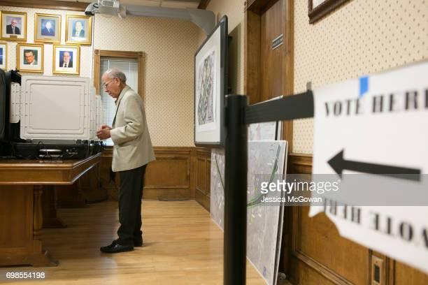 Hien Vo casts his vote at Doraville City Hall for the 6th Congressional District runoff election between Republican Karen Handel and Democrat Jon...