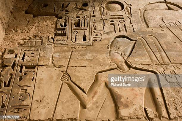 Hieroglyphs on the first pylon at the ancient Egyptian site of Medinet Habu the Mortuary Temple of Ramesses III in Luxor Nile Valley Egypt Medinet...