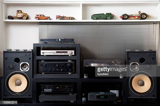 Hi-Fi sound system with vintage tin toy car