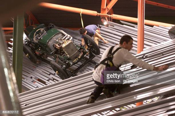 High access workers Marcus Raven and Jake Marcuson install the first cars in the new Motorsport Gallery at the National Motor Museum in Beaulieu The...