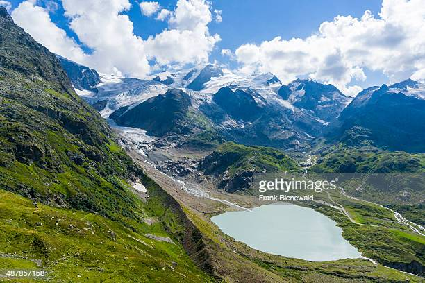 INNERTKIRCHEN BERN SWITZERLAND High altitude landscape with mountains glaciers green meadows and a lake at Sustenpass