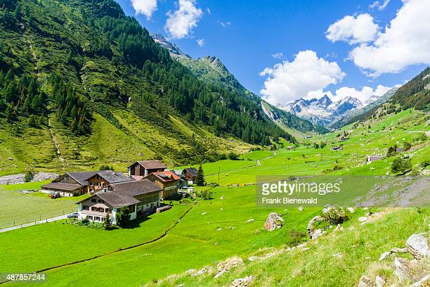 WASSEN GRAUBUENDEN SWITZERLAND High altitude landscape with some farmers houses mountains and green meadows at Sustenpass