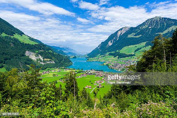 LUNGERN OBWALDEN SWITZERLAND High altitude landscape with the Lungernsee a village mountains and green meadows at the bottom of Bruenigpass