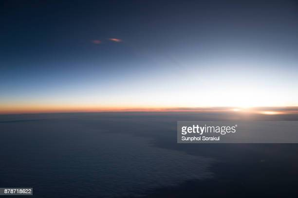 A high altitude view of sunsetting on the horizon