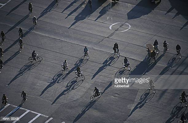 high angle abstract photograph of a city street crowded with people traveling on bikes