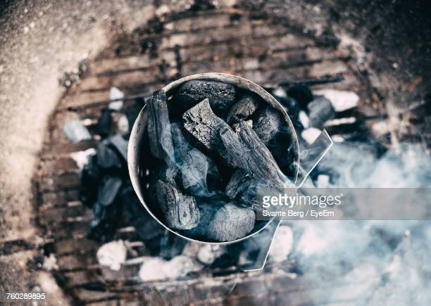 High Angle Close-Up Of Coal On Barbecue