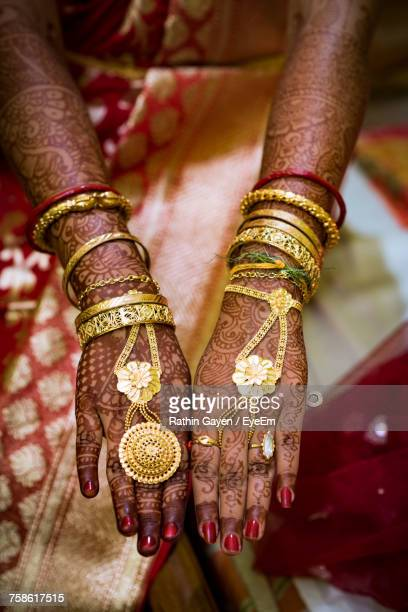 High Angle Midsection Of Bride Showing Hands With Henna Tattoo