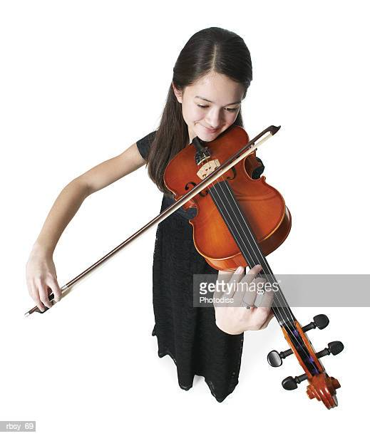 high angle portrait of an asian teenage girl in a black dress as she plays her violin