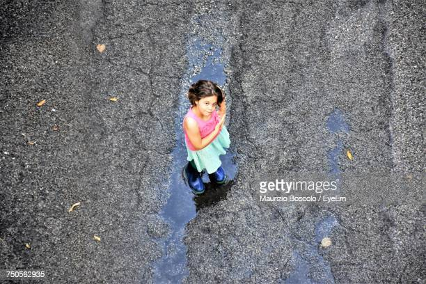 High Angle Portrait Of Girl Standing On Street