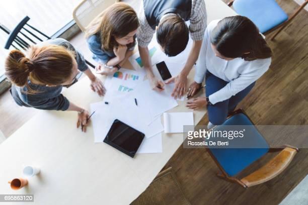 High angle shot of new entrepreneurs having a startup meeting