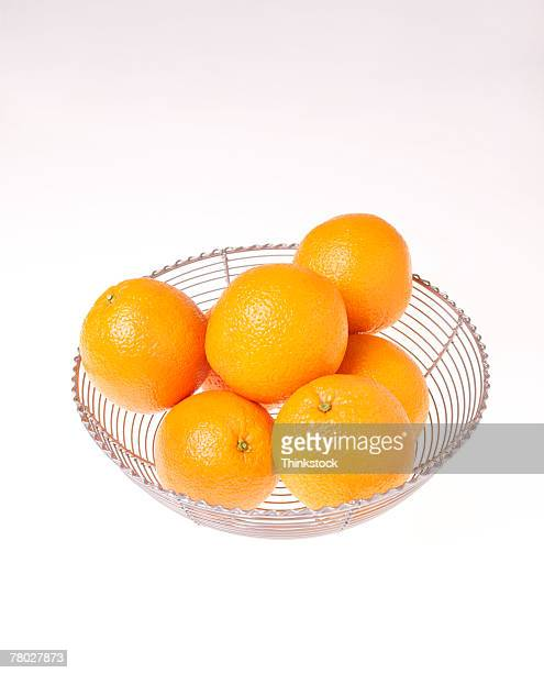 High angle still life of a glass bowl full of oranges