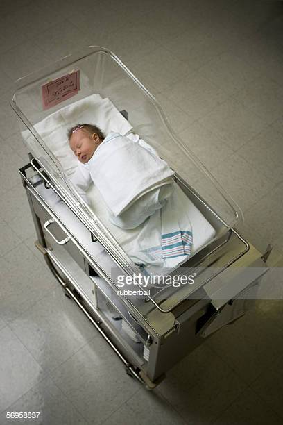 High angle view of a baby boy lying in a hospital nursery