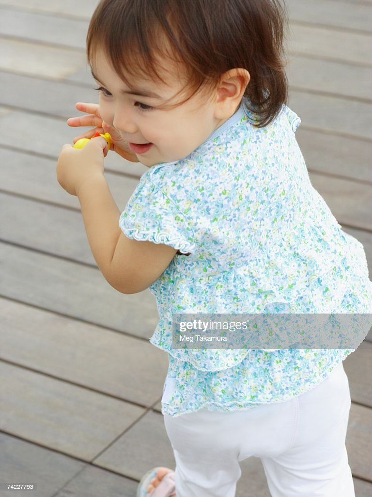 High angle view of a baby girl standing : Stock Photo