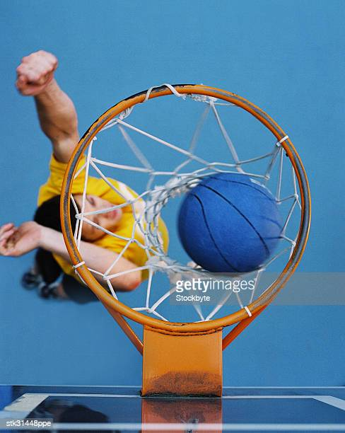 high angle view of a basketball player shooting the ball in the basket