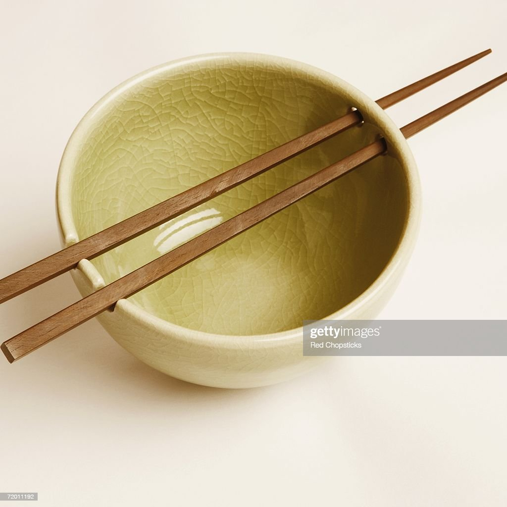High angle view of a bowl and two chopsticks : Stock Photo