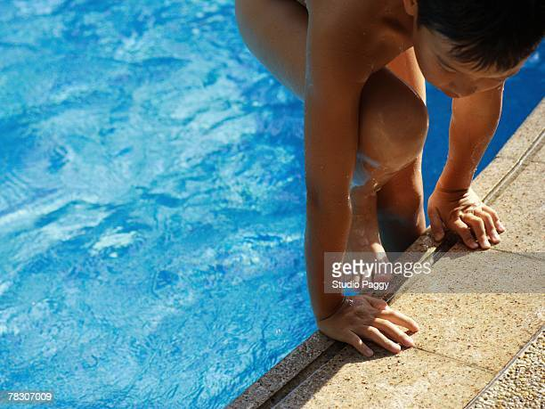 High angle view of a boy coming out of a swimming pool