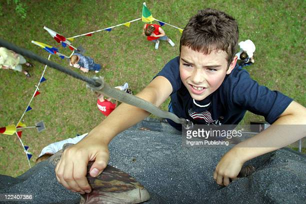 High angle view of a boy rock climbing