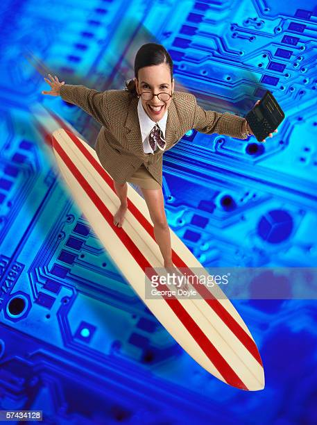 high angle view of a business woman surfing on a circuit board