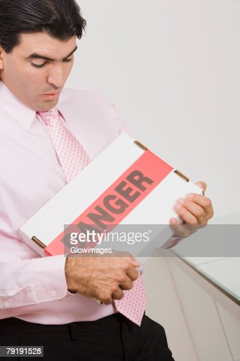 High angle view of a businessman carrying a package : Stock Photo