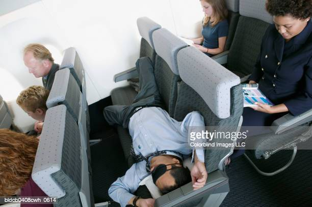 High angle view of a businessman sleeping in an airplane