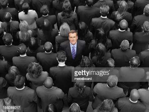 High angle view of a businessman standing amidst businesspeople : Foto de stock