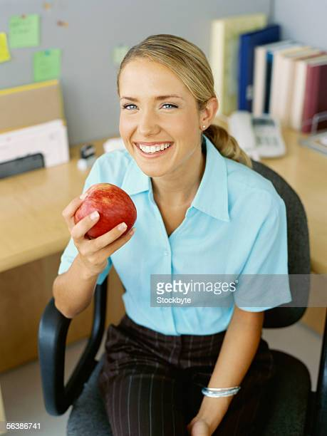 high angle view of a businesswoman holding an apple