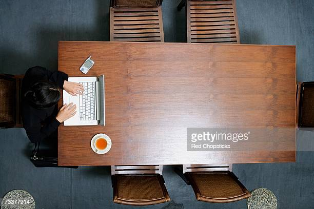 High angle view of a businesswoman using a laptop