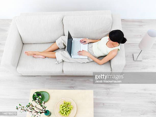 High angle view of a businesswoman using laptop on sofa