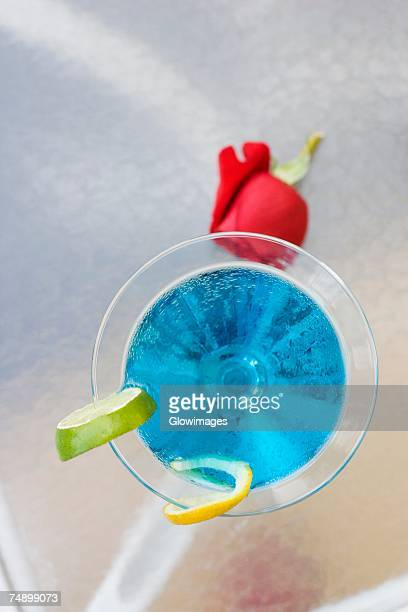 High angle view of a cocktail with slices of lime on the table