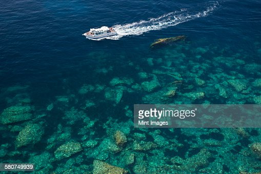 High angle view of a cruise ship on the calm clear waters of the Mediterranean.