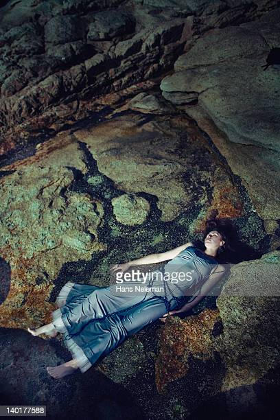 High angle view of a dead woman on rocks
