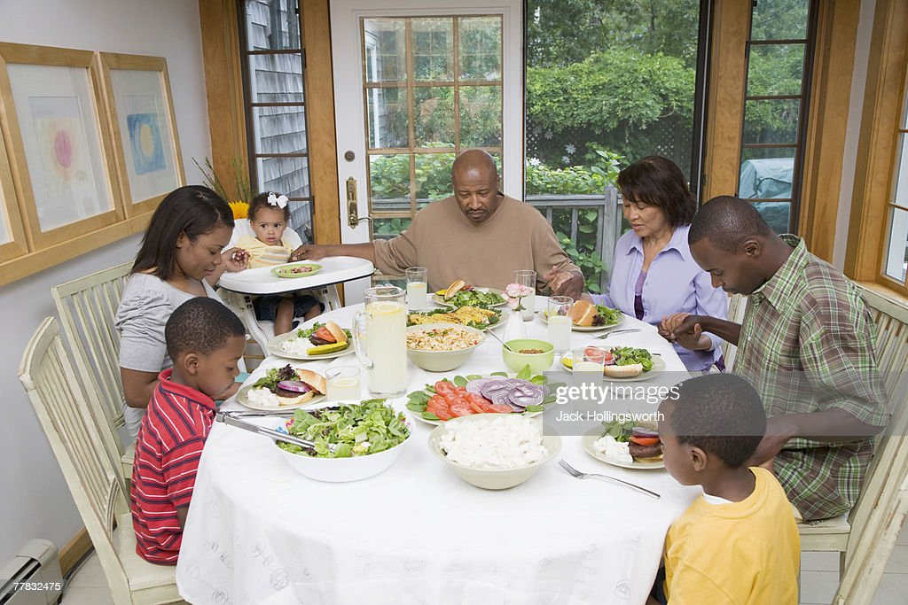 High angle view of a family having breakfast : Stock Photo