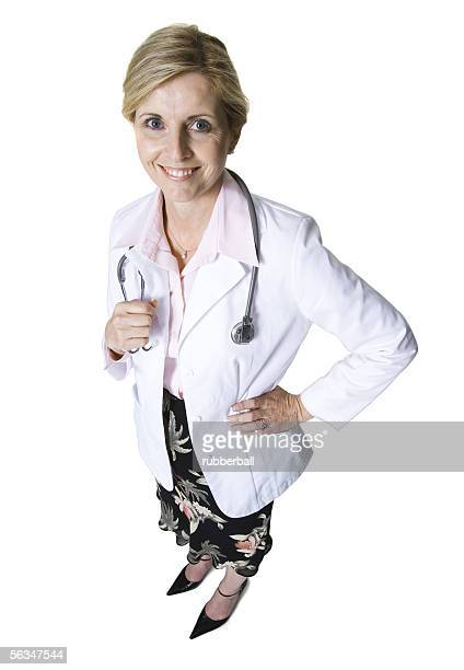 High angle view of a female doctor standing with her hand on her hip