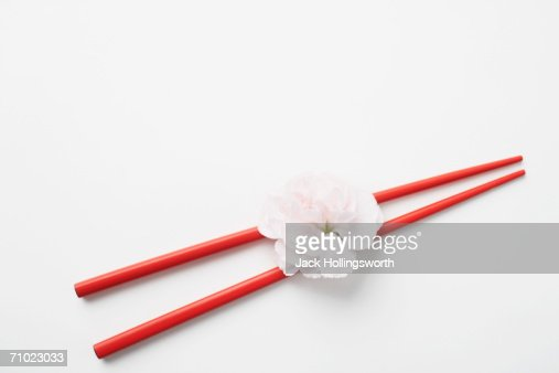 High angle view of a flower with a pair of chopsticks : Stock Photo