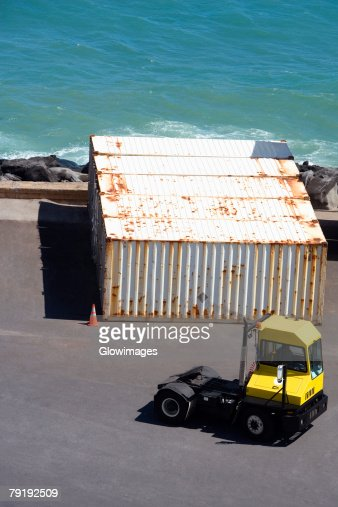 High angle view of a forklift and cargo containers at a commercial dock : Foto de stock