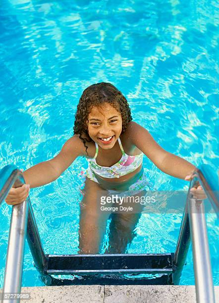 High angle view of a girl coming out of the swimming pool