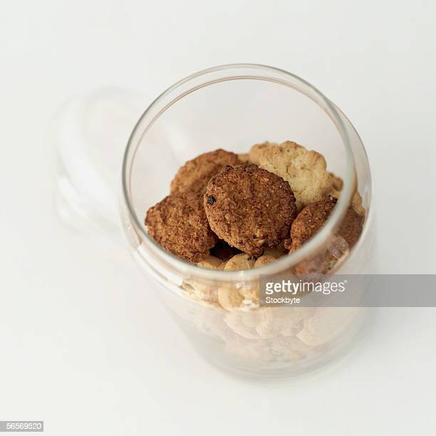 high angle view of a jar of assorted cookies