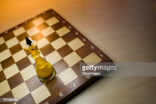 High angle view of a king chess piece on a chessboard : Stock Photo