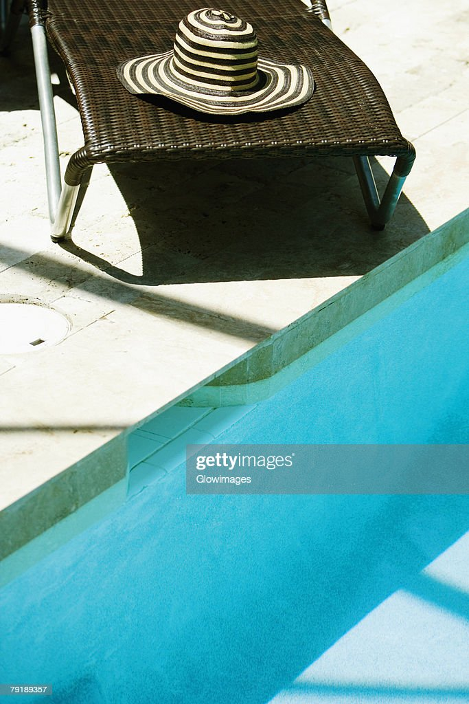 High angle view of a lounge chair at the poolside : Foto de stock