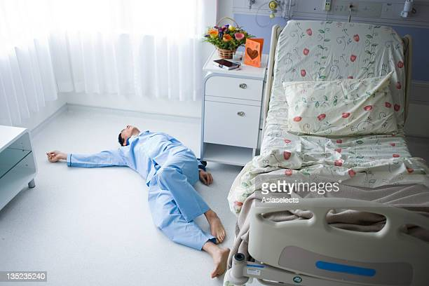High angle view of a male patient lying unconscious on the floor