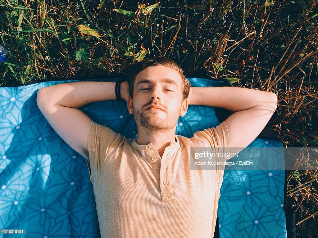High Angle View Of A Man Lying Outdoors